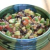 Texas Caviar with Avocado Recipe - Black-eyed peas, fresh avocado slices, and tomatoes highlight this spicy, flavor filled dip! Scoop it up by the chipful, and enjoy!