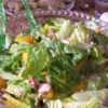 Mandarin Almond Salad Recipe - Romaine, Mandarin oranges and green onions are coated with a sweet, sour and peppery dressing and then sprinkled with lovely sugared almonds.