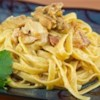 Fettuccini Carbonara Recipe - Bacon, shallots, onion and garlic, cooked in a thick creamy sauce, and tossed with fettuccini.