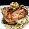 Pork Chops Stuffed with Smoked Gouda and Bacon Recipe - Center-cut pork chops, stuffed with gouda cheese, parsley, and bacon are excellent grilled or broiled.