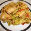 Carol's Arroz Con Pollo Recipe - Chicken nestled in a melange of saffron rice, wine, vegetables, onion and garlic.