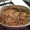 Green Bean Casserole IV Recipe - A creamy onion, cheddar and sour cream sauce is poured over green beans and then topped with bread stuffing mix in this baked accompaniment to meat or poultry.