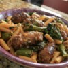 Penne with Sausage and Broccoli Rabe Recipe - Spicy Italian sausage and bitter broccoli rabe (rapini) are seasoned with a hearty dose of chile flakes and Parmesan cheese in this savory main dish.