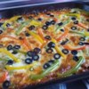 Zucchini Pizza Bake Recipe - A cheesy zucchini crust is filled with a beefy tomato sauce, fresh vegetables, and Mozzarella cheese.