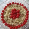 Red, White and Blue Slaw Salad Recipe - The name hints at all the colors in this marvelous coleslaw. Blue cheese is mixed into a creamy white dressing, while cherry tomatoes add bright red color to make this salad simply memorable.
