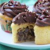 Chocolate Chip Cookie Dough + Cupcake = The BEST Cupcake.  Ever. Recipe and Video - Cookies, cupcakes? You don't have to choose. These cupcakes have a hidden chocolate chip cookie dough center for the undecided among us.