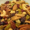 Karli's Ultimate Trail Mix Recipe - Dried cranberries and golden raisins sparkle in this mix of nuts and snack sticks.