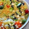 Party-Size Greek Couscous Salad Recipe - If you are tired of the same old potato or macaroni salad and want raves, try this at your next picnic or pot luck! This recipe can be easily adapted depending on the veggies and dressing you use. Salad can be made the night before; however, add dressing just before serving.