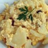 Cheesy Potatoes I Recipe - Cheesy potatoes make the perfect side dish. Sliced potatoes are layered with cheese and onion in this crowd pleasing variation on scalloped potatoes.