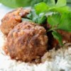Zesty Porcupine Meatballs Recipe - Condensed tomato soup and beaten egg are combined with ground beef, rice, chopped onion, parsley, and seasonings. The mixture is formed into meatballs, and simmered in a covered skillet with additional soup and Worcestershire sauce for 20 to 30 minutes.