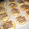 Easy Chocolate Covered Coconut Macaroons Recipe - Soft and chewy coconut cookies half-dipped in melted semi-sweet chocolate!
