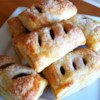 Raspberry Pain au Chocolat (Raspberry Chocolate Croissants) Recipe and Video - Flaky puff pastry is filled with chocolate-hazelnut spread and all-fruit raspberry spread in this delectable treat.