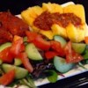 Easy Polenta with Tomato Sauce Recipe - My entire family loves this recipe. A quick baked polenta topped with red sauce. Very easy to make and great the next day too (and the day after that!) Top with additional Parmesan cheese if you like.
