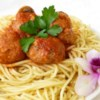 Jenn's Out Of This World Spaghetti and Meatballs Recipe - This authentic spaghetti and meatballs recipe is made with fresh oregano and parsley. Because the meatballs are cooked in the sauce, they are tender and savory.