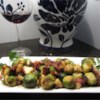 Roasted Apples and Brussels Sprouts Recipe - Frozen Brussels sprouts get an upgrade in flavor when roasted with apple and sweet onion chunks and drizzled with lemon. You don't even have to thaw the sprouts--just pour them frozen from the bag onto the baking sheet, season, and roast.