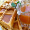 Pumpkin Waffles with Apple Cider Syrup Recipe - These waffles contain two of our favorite seasonal flavors: pumpkin and apple cider.