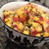 Fresh Mango Salsa Recipe - Lime juice and cider vinegar balance the sweetness of the tomatoes, onion, mango, and sugar in this salsa recipe.
