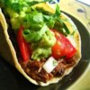 Spicy Shredded Beef Recipe - Browned, cubed beef is simmered with diced tomatoes, cumin, and garlic, then shredded. This makes good filling for Tex-Mex style dishes, and freezes well.