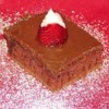 Texas Sheet Cake II Recipe - Rich, moist, easy chocolate cake to feed a crowd. Small serving is more than enough. Great for community dinners or large get togethers of any sort.
