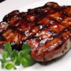 Grilled Pork Loin Chops Recipe and Video - Boneless pork loin chops, marinated in a tangy sweet-and-savory marinade with a hint of spice, grill up all moist and browned for a delightful grilled supper for two.
