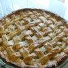 Pineapple Pie III Recipe -  Baked pineapple is showcased beautifully in this double-crusted pie. The pineapple filling is cooked a bit on the stove to thicken and blend the flavors, and then it 's piled into a prepared crust, topped with another and slipped into the oven to bake. Serve warm with mounds of vanilla ice cream.