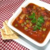 Martha's Vegetable Beef Soup Recipe - Ground beef and a package of frozen vegetables are your two main shopping list items for this quick-to-make soup.  A hearty stock is provided by tomato sauce, dry onion soup mix, and a teaspoon of white sugar.