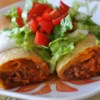 Chicken Chimi in the Oven Recipe - A fragrant, spicy chicken mixture is rolled up in flour tortillas and baked. This is my absolute favorite recipe! Serve with salsa, sour cream, and guacamole.