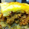 Bacon Cheeseburger Upside Down Pizza Recipe - An original use of ground beef, mixed with prepared pizza sauce, onion, cheddar cheese, and bell pepper. It is topped with an egg crust.