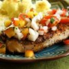 Grilled Pork Chops with Fresh Nectarine Salsa Recipe - A summertime salsa livens up spicy, grilled pork chops with sweet-tangy flavors from nectarines and tomatoes sparked by onions, cilantro, chile pepper flakes, and lime juice.