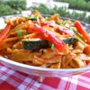 Shanghai Noodle Salad Recipe and Video - This Asian-inspired pasta salad, made with thick Chinese noodles, is seasoned with toasted sesame seeds and has a tangy sweet-and-sour dressing designed to cool you off on a hot day. Red bell peppers, carrots, and zucchini give it bright colors.
