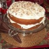 Cream of Coconut Cake Recipe - Cream of coconut and sour cream help this cake recipe deliver a wonderfully moist coconut cake with a cream cheese icing.