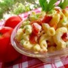 Bacon, Lettuce, and Tomato Macaroni Salad Recipe - The delicious flavors of crisp crumbled bacon and tangy fresh tomato that you love in a BLT sandwich dress up a bowl of macaroni salad that's perfect for a light lunch or side dish.