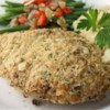 Tender Italian Baked Chicken Recipe and Video - This baked chicken recipe is ready in just 30 minutes. An easy breadcrumb and Parmesan coating keeps each chicken breast moist and delicious.