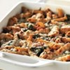 Three-Cheese Chicken Penne Pasta Bake Recipe - Chunks of chicken in a creamy tomato sauce with basil and fresh spinach are baked with multi-grain penne pasta and topped with cheese.