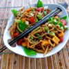 Easy Asian Pasta Salad Recipe - Pasta tossed in a sesame oil and soy sauce-based dressing is a refreshing, Asian-inspired side dish perfect for picnics.
