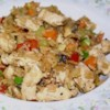 Quick Pork Fried Rice Recipe - Some cooked rice, cooked pork, and a few vegetables combine into a colorful and hearty Asian-inspired fried rice dish you can make with leftovers.