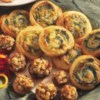 Spinach-Cheese Swirls Recipe - Savory spinach, onion and tangy cheese filling is rolled up in flaky puff pastry for tempting appetizer pinwheels.
