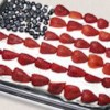 Red, White and Blue Strawberry Shortcake Recipe and Video - This yellow cake is frosted with whipped topping and decorated with blueberries and strawberries for the stars and stripes on the American flag.