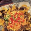 Nachos Grande Recipe - Hearty, man-sized nachos feature Pace(R) Salsa-seasoned ground beef, a creamy cheese sauce, onion, tomato and jalapeno for topping tortilla chips. Feed a crowd as an appetizer or serve for dinner!