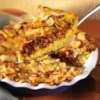 1-Dish Taco Bake Recipe - Here's a one-dish family pleaser with all your favorite Mexican ingredients--salsa, cheese, taco seasoning and corn chips.