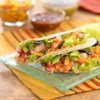 Grilled Shrimp Tacos Recipe - Hot, grilled shrimp are dressed with a sauce made from Taco Ranch Dressing, and served on warmed flour tortillas.