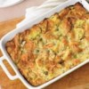 Two-Salmon Strata with L'Evanjules Recipe - Cooked and smoked salmon are layered with cheese and croissants and topped with an egg, sour cream, caper and dill mixture before baking to a bubbly brown to serve.