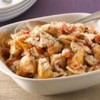 Creamy Chicken, Bacon and Tomato Pasta Recipe - Chunks of tender chicken are simmered in a creamy tomato sauce with bacon, tossed with farfalle pasta, and sprinkled with Parmesan cheese for a quick and tasty weeknight dinner.