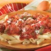 Italian Sausage and Peppers with Penne Recipe - Cook up this delicious Italian dinner of browned Italian sausage, bell peppers, and onions simmered with pasta sauce and served over penne pasta with parmesan cheese.