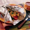 Backyard BBQ Chicken Recipe - Delicious barbecue chicken, corn, and chopped bell pepper are cooked in foil packets--and clean-up is a breeze.