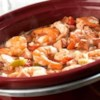 Slow Cooker Jambalaya Recipe - This delectable, slow-cooked version of a traditional New Orleans-style dish features chicken, kielbasa and shrimp in a bed of rice that's been seasoned with Creole seasoning, green pepper, celery and diced tomato.