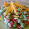 Bacon Ranch Pea Salad Recipe - Peas, bacon, cheese, onions, and Ranch dressing are tossed together and chilled in this great summer salad.