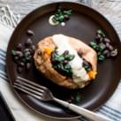 Stuffed Sweet Potato with Hummus Dressing