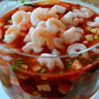 Original Mexican Shrimp Cocktail - Shrimp with tomatoes, avocados, sweet onion, and cilantro bask in a zesty tomato salsa for an appetizer that looks beautiful when served in a glass salad bowl. Serve with saltine crackers.
