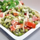 Green Pea Salad - Pickles seem to work wonders for this simple salad.  Sweet pickles are mixed in with the peas and other salad ingredients, and pickle juice is mixed into the dressing.